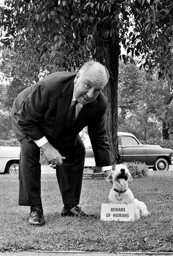 August 29, 1956 Alfred Hitchcock with dog. t11041_20 Copyright CBS Broadcasting, Inc., All Rights Reserved, Credit: CBS Photo Archive